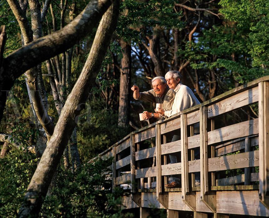 Senior couple enjoying the view from a walking bridge, Outer Banks, North Carolina