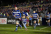 Matt Garvey of Bath Rugby, mascot in hand, leads his team onto the field. Aviva Premiership match, between Bath Rugby and Wasps on December 29, 2017 at the Recreation Ground in Bath, England. Photo by: Patrick Khachfe / Onside Images