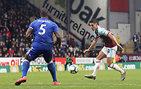 Burnley's Ashley Westwood under pressure from Leicester City's Wes Morgan<br /> <br /> Photographer Rich Linley/CameraSport<br /> <br /> The Premier League - Burnley v Leicester City - Saturday 16th March 2019 - Turf Moor - Burnley<br /> <br /> World Copyright © 2019 CameraSport. All rights reserved. 43 Linden Ave. Countesthorpe. Leicester. England. LE8 5PG - Tel: +44 (0) 116 277 4147 - admin@camerasport.com - www.camerasport.com