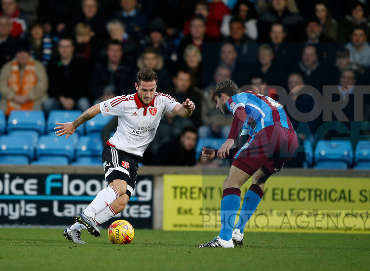 Billy Sharp of Sheffield Utd takes on Scott Wiseman of Scunthorpe Utd - English League One - Scunthorpe Utd vs Sheffield Utd - Glandford Park Stadium - Scunthorpe - England - 19th December 2015 - Pic Simon Bellis/Sportimage