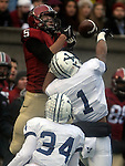 (Cambridge Ma 11/22/14) The pass to Harvard, 5, Ricky Zorn, by Yale 1 Dale Harris, also on the play is Yale,  34, Robert Ries,  in the first half, as Harvard defeated Yale 31-24. Jim Michaud Photo
