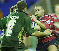20/01/02 - Powergen  Cup - Quarter Final<br /> Madejski Stadium - Reading <br /> London Irish v Gloucester:<br /> Gloucester prop, Federico Pucciaello runs into defender Brenden Venter.[Mandatory Credit:Peter SPURRIER/Intersport Images]
