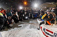 Media take photos of Pete Kaiser and his lead dogs at the Nome finish line after Pete won the 2019 Iditarod Trail Sled Dog Race. Pete's winning time is 9 days 12 hours 39 minutes and 6 seconds<br /> <br /> Photo by Jeff Schultz/  (C) 2019  ALL RIGHTS RESERVED