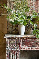 Detail of the distressed paint finish on a wooden mantelpiece in one of the bedrooms