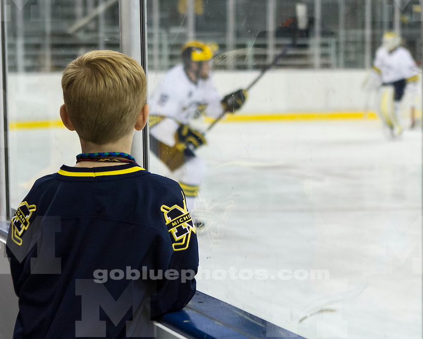 The University of Michigan men's ice hockey team hosted the Blue/White Alumni game (Blue 4, White 2) and Skate With the Wolverines at Yost Ice Arena in Ann Arbor, Mich., on October 7, 2012.