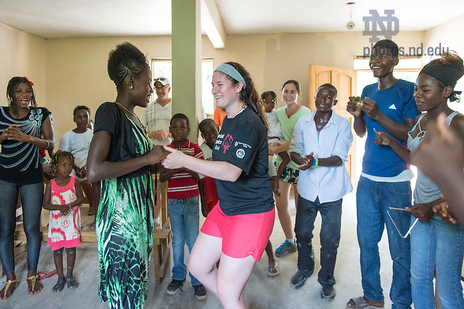 Aug. 11, 2015; Bernadette Jordan dances with a resident in a classroom at St. Gabriel School in Fontaine, Haiti. (Photo by Barbara Johnston/University of Notre Dame)
