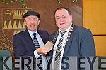 CHANGE: Outgoing mayor of Kerry, Michael Healy-Rae handing over the chain of office to the.newly elected mayor of Kerry, Tom Fleming, in the Kerry County Council Chambers on Wednesday.