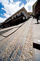 A STEEP AND NARROW COBBLESTONE STREET OF CUZCO,PERU