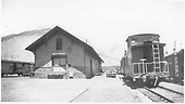 D&amp;RGW Silverton depot surrounded by freight cars.  A large crowd has formed on the agent's end (north) of the depot.<br /> D&amp;RGW  Silverton, CO