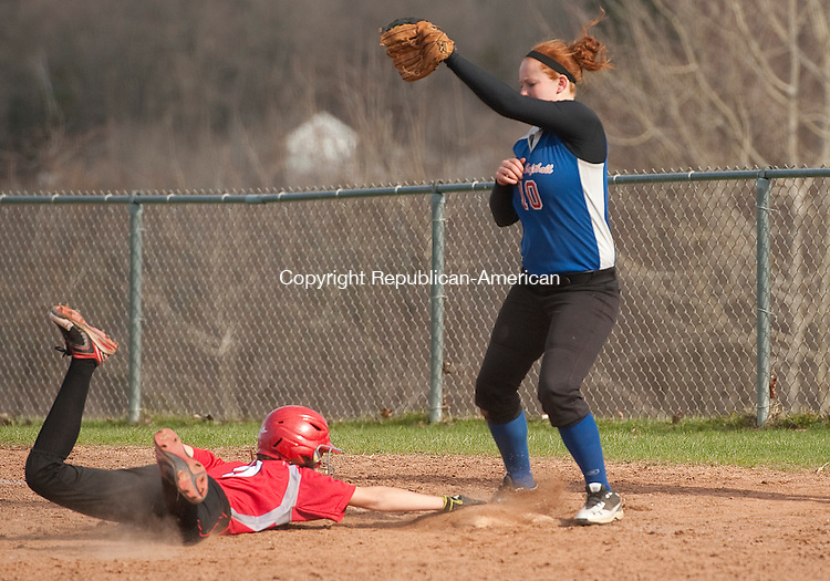 WINSTED, CT-0426014JS07- Northwestern's Micheala Cisowski (9) dives back safely to first in front of the tag by Nonnewaug's Shannon Kimberly (10) during their game Monday at Northwestern Regional High School in Winsted. <br /> Jim Shannon Republican-American