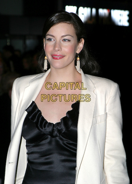 LIV TYLER.The Lord Of The Rings: The Return Of The King UK premiere, Odeon Leicester Square.11 December 2003.half length, half-length, drop dangly earrings.www.capitalpictures.com.sales@capitalpictures.com.© Capital Pictures.