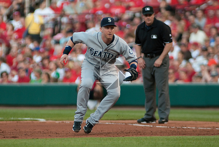 June 14, 2010         Seattle Mariners first baseman Mike Carp (20) reacts to a Cardinals batter and shifts position early in the game.   In background is first base umpire Marty Foster.  The St. Louis Cardinals defeated the Seattle Mariners 9-3 in the first game of a three-game homestand at Busch Stadium in downtown St. Louis, MO on Monday June 14, 2010.