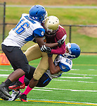 WATERBURY,  CT-101219JS12- Crosby's Michail Scott (16) and Stephen Diggs (23) bring down Sacred Heart-Kaynor's Takai Coleman (33) during their game Saturday at Municipal Stadium in Waterbury.<br /> Jim Shannon Republican-American
