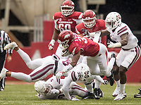Hawgs Illustrated/BEN GOFF <br /> David Williams, Arkansas running back, goes down after a hit from Johnathan Abram, Mississippi State safety, in the fourth quarter Saturday, Nov. 18, 2017, at Reynolds Razorback Stadium in Fayetteville.
