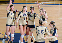Florida International University women's volleyball players celebrate during the game against Arkansas State University.  FIU won the match 3-2 on October 21, 2011 at Miami, Florida. .