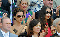 OIC - ENTSIMAGES.COM -  Victoria Beckham watches Andy Murray of Great Britain celebrates his win in the Gentlemen's Singles Final match against Novak Djokovic of Serbia of the Wimbledon Lawn Tennis Championships at the All England Lawn Tennis and Croquet Club 7th July 2013     Photo Ents Images/OIC 0203 174 1069