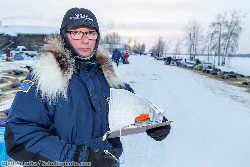 Volunteer Comms Jerry Trodden works the checkpoint on the banks of the Yukon river at the Tanana checkpoint on Wednesday morning  March 11th during the 2015 Iditarod.<br /> <br /> (C) Jeff Schultz/SchultzPhoto.com - ALL RIGHTS RESERVED<br />  DUPLICATION  PROHIBITED  WITHOUT  PERMISSION