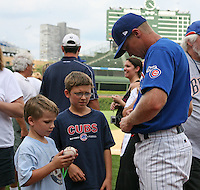 August 9, 2009:  Matt Matulia of the Iowa Cubs signs autographs after a game at Wrigley Field in Chicago, IL.  Iowa is the Pacific Coast League Triple-A affiliate of the Chicago Cubs.  Photo By Mike Janes/Four Seam Images