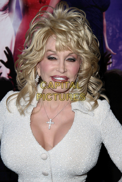 "Dolly Parton.""Joyful Noise"" Los Angeles Premiere held at Grauman's Chinese Theatre, Hollywood, California, USA..January 9th, 2012.headshot portrait white dress sparkly cleavage necklace cross crucifix .CAP/ADM/CH.©Charles Harris/AdMedia/Capital Pictures"
