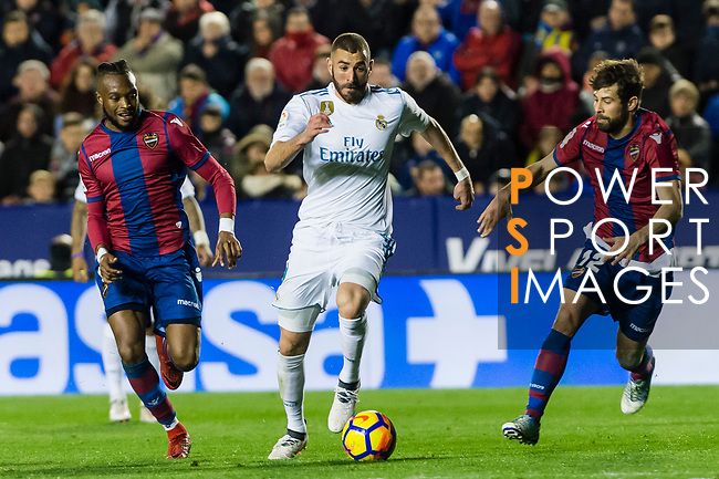 Karim Benzema of Real Madrid (C) fights for the ball with Cheik Doukoure of Levante UD (L) and Jorge Andujar Moreno, Coke, of Levante UD (R) during the La Liga 2017-18 match between Levante UD and Real Madrid at Estadio Ciutat de Valencia on 03 February 2018 in Valencia, Spain. Photo by Maria Jose Segovia Carmona / Power Sport Images