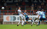 Sam Saunders of Wycombe Wanderers flicks a shot at goal over Jack Cook of Aldershot Town during the pre season friendly match between Aldershot Town and Wycombe Wanderers at the EBB Stadium, Aldershot, England on 22 July 2017. Photo by Andy Rowland.