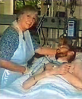 Pictured: Peter Bowen with his mother in his hospital bed. Re: Convicted murderer David Wyn Davies, stabbed a door at his home while imitating the horror shower scene from the film Psycho, in Swansea, Wales, UK.<br /> 38 year old David Wyn Davies, pretended to be the Norman Bates, the character from the film, and made the terrifying sounds from the famous Hitchcock thriller.<br /> But he remains in prison after being recalled to serve more of his initial life sentence.<br /> Davies was sent to jailed for life in 2005 for the murder of Peter Bowen, homeless man in Swansea city centre in June 2000.<br /> He kicked and stabbed Mr Bowen twice. He then carried on with the attack even as rescuers tried to treat his victim.