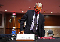 Dr. Anthony Fauci, director of the National Institute for Allergy and Infectious Diseases, prepares to leave after testifying before the Senate Health, Education, Labor and Pensions (HELP) Committee on Capitol Hill in Washington DC on Tuesday, June 30, 2020.  Fauci and other government health officials updated the Senate on how to safely get back to school and the workplace during the COVID-19 pandemic.<br /> Credit: Kevin Dietsch / Pool via CNP /MediaPunch