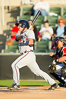 Casey Kalenkosky (32) of the Rome Braves follows through on his swing against the Kannapolis Intimidators at CMC-Northeast Stadium on April 25, 2013 in Kannapolis, North Carolina.   (Brian Westerholt/Four Seam Images)