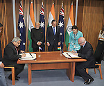 AUSTRALIA, Canberra : Indian Prime Minister Narendra Modi (CL) and Australian Prime Minister Tony Abbott (CR) watch as a memorandum of understanding in the field of the arts is signed by the Indian Minister of External Affairs Anil Wadhwa (L) and the Australian Minister for the Arts George Brandis (R) at Parliament House, Canberra on November 18, 2014. AFP PHOTO / MARK GRAHAM
