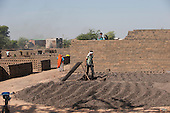 Rajasthan, India. Nr. Ranthambore National Park. Brickmaking.