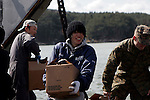 OSHIMA, Japan - A Japanese local smiles while unloading supplies from a landing craft utility, March 27. The 31st Marine Expeditionary Unit and Amphibious Squadron 11 delivered food, water, health and comfort supplies, and Japanese electrical utility vehicles to the isolated island of Oshima, in conjunction with Japanese Self-Defense Forces. The 31st involvement is part of a larger U.S. government response, after a 9.0 earthquake and subsequent tsunami struck Japan causing widespread damage. The 31st MEU is ready to support our Japanese partners and to provide assistance when called upon. (Photo by USMC/AFLO) [0006]