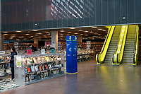 Book shelves and escalators in the Living Room on Level 3  of Seattle Central Library building in downtown Seattle, Washington state, USA