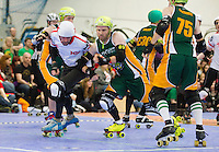 15 MAR 2014 - BIRMINGHAM, GBR - Team England jammer Ballistic Whistle (left) tries to evade a challenge from Kernel Panic of the Wizards of Aus during the inaugural Men's Roller Derby World Cup at the Futsal Arena in Birmingham, West Midlands, Great Britain (PHOTO COPYRIGHT © 2014 NIGEL FARROW, ALL RIGHTS RESERVED)