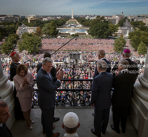Pope Francis, foreground bottom, arrives  with House and Senate leadership as well as local clergy to gather on the balcony of the Speaker of the House after he delivered an address to a joint session of Congress on September, 24, 2015 in Washington, DC. From left are Cardinal Archbishop Donald Wuerl, Rep. Nancy Pelosi(D-CA), Rep. John Bohner, Rep. Kevin McCarthy(R-CA), Pope Francis, Vice President Joe Biden, Sen. Mitch McConnell(R-KY), Sen. Harry Reid(D-NV), and Archbishop of Louisville, Kentucky Joseph Kurtz.<br /> Credit: Bill O'Leary / Pool via CNP
