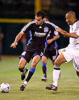 18 April 2009: Pablo Campos of the Earthquakes dribbles the ball away from Tony Sanneh of the Galaxy during the game at Oakland-Alameda County Coliseum in Oakland, California.   Earthquakes and Galaxy are tied 1-1.