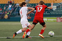 Rochester, NY - Friday June 17, 2016: Western New York Flash defender Elizabeth Eddy (4), Portland Thorns FC midfielder Tobin Heath (17) during a regular season National Women's Soccer League (NWSL) match between the Western New York Flash and the Portland Thorns FC at Rochester Rhinos Stadium.