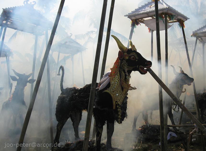 sarcophage sculpture of a bull burning  in cremation ceremonies in village Petulu, north of Ubud, , Bali, archipelago Indonesia
