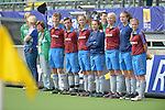 The Hague, Netherlands, June 03: Ball kids lined up at the sideline prior to the national anthems of the teams during the field hockey group match (Women - Group B) between South Africa and Germany on June 3, 2014 during the World Cup 2014 at Kyocera Stadium in The Hague, Netherlands. Final score 1:3 (0:1) (Photo by Dirk Markgraf / www.265-images.com) *** Local caption ***