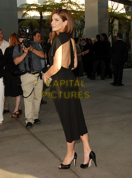 "SANDRA BULLOCK.Attends The Warner Brothers' Premiere of ""The Lake House"" held at The Arclight Theatre in Hollywood, California, Los Angeles, USA, June 13, 2006..full length black dress low cut plunging neckline clutch bag peeptoe shoes peep toe back backless looking over shoulder.Ref: DVS.www.capitalpictures.com.sales@capitalpictures.com.©Debbie VanStory/Capital Pictures"
