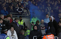 An Aston Villa fan waves a smoke bomb flare in front of a steward during the Sky Bet Championship match between Cardiff City and Aston Villa at The Cardiff City Stadium, Cardiff, Wales, UK. Monday 02 January 2017