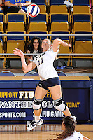 24 September 2010:  FIU's Ines Medved (11) hits a kill shot in the second set as the FIU Golden Panthers defeated the University of Denver Pioneers, 3-0 (29-27, 25-16, 25-20), at U.S Century Bank Arena in Miami, Florida.
