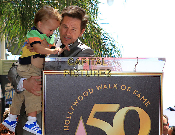 MARK WAHLBERG with son, Brendan Joseph Wahlberg .Mark Wahlberg is honored on The Hollywood Walk of Fame with the 2414th Star, Hollywood, CA, USA, .29th July 2010..half length family child kid podium holding grey gray suit tie microphone speaking .CAP/ADM/FS.©Faye Sadou/AdMedia/Capital Pictures.