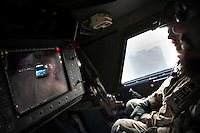 Afghanistan, 23.10.2011, Nawabad. Der Dachschuetze beobachtet ein Auto hinter dem Konvoi auf dem Bildschirm. Die in Kundus stationierte 3. Task Force (ISAF) der Bundeswehr beginnt im Oktober 2011 die mehrtaegige Operation Orpheus. Durch Patrouillen in und um die Kleinstadt Nawabad (Dirstrikt Chahar Dareh) westlich von Kundus, Nordafghanistan, versuchen die rund 100 Infanteristen Rueckzugsorte Aufstaendischer unmoeglich zu machen. Unterstuetzt werden sie dabei durch einen Zug afghanischer Soldaten. A top gunner oberves the surrounding during a patrol and focuses on a approaching car. In October 2011 Kunduz based 3.Task Force started a several days operation in and around Nawabad (District Chahar Dareh), west of Kunduz, northern Afghanistan. During the Operation Orpheus about 100 german infantry soldiers went out for patrols through the town and surrounding areas, which were expected as a retreat zone of insurgents. A platoon of afghan soldiers supports the german forces. © Timo Vogt/Est&Ost, NO MODEL RELEASE !! © Timo Vogt/Est&Ost, NO MODEL RELEASE !!