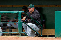 Augusta GreenJackets pitching coach Steve Kline (34) watches the action from the dugout during the South Atlantic League game against the Greensboro Grasshoppers at NewBridge Bank Park on August 11, 2013 in Greensboro, North Carolina.  The GreenJackets defeated the Grasshoppers 6-5 in game one of a double-header.  (Brian Westerholt/Four Seam Images)