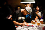 Tokyo, August 30 2012 - Dengaryu, hip hop singer and actor in the movie Saudade by Katsuya Tomita, signing a CDafter his concert in Shibuya.