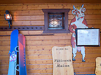 Switzerland. Canton Valais. Verbier is a village located in the municipality of Bagnes in the Val de Bagnes. The milk bar is a cafe and restaurant serving food based on milk. A pair of snowboards and a fake cow with a menu board. Verbier is one of the largest holiday resort and ski areas in the Swiss Alps. 4.01.2012 © 2012 Didier Ruef