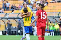 ATENÇÃO EDITOR FOTO EMBARGADA PARA VEÍCULOS INTERNACIONAIS - SAO PAULO, SP, 09 DE DEZEMBRO DE 2012 - TORNEIO INTERNACIONAL CIDADE DE SÃO PAULO - BRASIL x PORTUGAL: Mariana .comeora segundo gol do Brasil durante partida Brasil x Portugal, válido pelo Torneio Internacional Cidade de São Paulo de Futebol Feminino, realizado no estádio do Pacaembú em São PauloFOTO: LEVI BIANCO - BRAZIL PHOTO PRESS