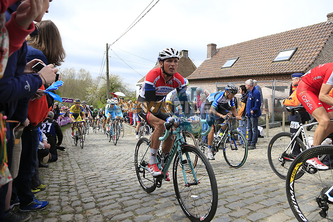 The peleton, including Johnny Hoogerland (NED) Androni Giocattoli-Venezeula, climb the Molenberg during the 2014 Tour of Flanders, Belgium.<br /> Picture: Eoin Clarke www.newsfile.ie