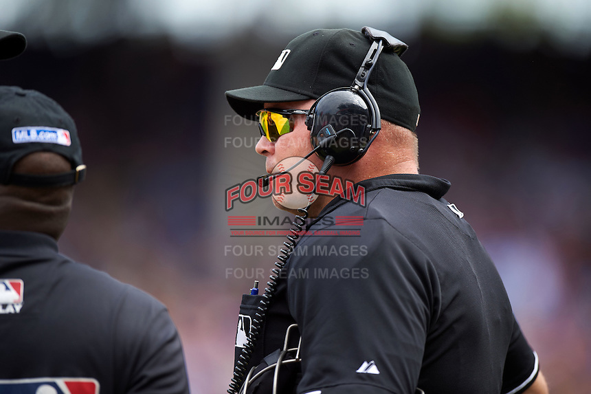 Umpire Mark Carlson waits for a review of a Dexter Fowler (not pictured) home run during a game between the Milwaukee Brewers and Chicago Cubs on August 13, 2015 at Wrigley Field in Chicago, Illinois.  Chicago defeated Milwaukee 9-2.  (Mike Janes/Four Seam Images)