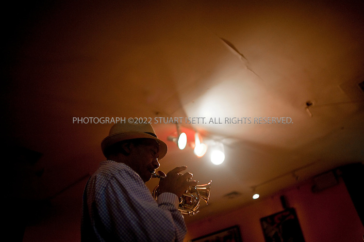 """5/16/2009--New York, NY, USA..Musician Olu Dara performs at Creole in Harlem, New York City. ..Olu Dara (born Charles Jones III in Natchez, Mississippi[1] on 12 January 1941) is an American cornetist, guitarist and singer. He first became known as a jazz musician, playing alongside avant-garde musicians such as David Murray, Henry Threadgill, and Art Blakey...His first album under his own name, 1998's In the World: From Natchez to New York, revealed another aspect of his musical personality: the leader and singer of a band immersed in African-American tradition, playing an eclectic mix of blues, jazz, and storytelling, with tinges of funk, African popular music and reggae. His second album Neighborhoods, with guest appearances by Dr John and Cassandra Wilson, followed in a similar vein...Rapper Nas (Nasir Jones) is Dara's son. He encouraged his father to record the music he was playing with his band, and guested on """"Jungle Jay"""" from In the World. Dara played the cornet on the track """"Life's A Bitch"""" from Nas's debut album Illmatic in 1994. In 2004, his vocals and trumpet were featured on Nas's single """"Bridging the Gap"""", from his album Street's Disciple...He was given the name """"Olu Dara,"""" which literally translated means """"God is good,"""" by a Yoruba priest when he returned to America. Dara has traveled throughout Africa and Europe....©2009 Stuart Isett. All rights reserved."""